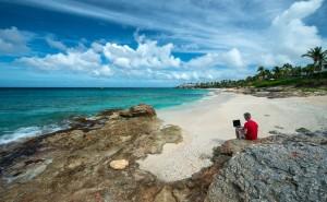 Man at work in a Caribbean beach